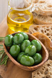 Fresh green olives, olive oil and ciabatta, top view Stock Image
