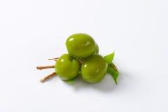 Fresh green olives. On white background Stock Photos