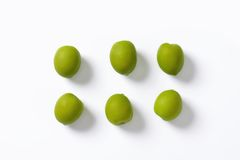 Fresh green olives. On white background Royalty Free Stock Images