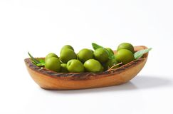 Fresh green olives in wood bowl. Fresh green olives in natural wood bowl Royalty Free Stock Photography