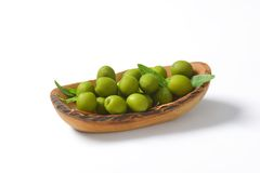 Fresh green olives in wood bowl Royalty Free Stock Photos
