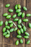 Fresh green olives. On wooden table from above Stock Photo