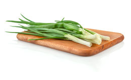 Fresh green onion on wooden board Stock Image