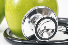 Fresh green organic apple nutrients naturally shaped stethoscope Royalty Free Stock Image