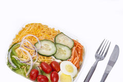 Fresh green organic garden salad with utensils. Royalty Free Stock Image