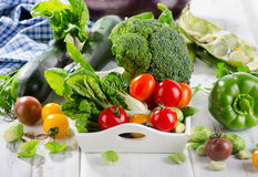 Fresh green organic vegetables on a white wooden background. Selective focus Stock Photo