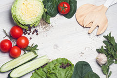 Fresh Green organic vegetables with wooden cutlery on wooden background. place for ypur text. Fresh Green organic vegetables with wooden cutlery on wooden Stock Images