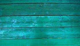 Fresh  green paint on wood background Stock Photo