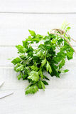 Fresh green parsley on white board Stock Photography