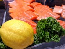 Fresh green  parsley and yellow lemon and Salmon. Fresh parsley and lemon and Salmon Royalty Free Stock Image