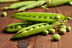 Fresh green pea pod on wood background Royalty Free Stock Photography