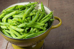 Fresh green pea pods in a bowl Royalty Free Stock Image