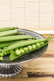 Fresh green pea pods in oriental dish Royalty Free Stock Photos