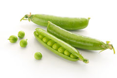 Fresh green pea pods and peas Royalty Free Stock Photos