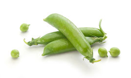 Fresh green pea pods and peas Royalty Free Stock Images