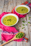 Fresh green pea soup with pea seeds. Royalty Free Stock Image