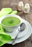 Fresh green pea soup (Selective Focus) Royalty Free Stock Photos