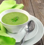 Fresh green pea soup (Selective Focus) Royalty Free Stock Photo