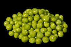 Fresh green peas. Green peas isolated on black background Stock Photo