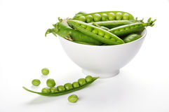 Fresh green peas. On a white bowl close up Stock Photography