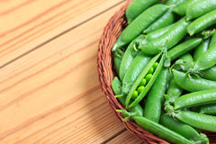 Fresh green peas in a basket Stock Photo