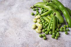 Fresh green peas and beans on light background. Top view Royalty Free Stock Photo