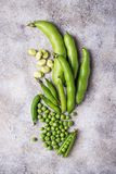 Fresh green peas and beans on light background. Top view Royalty Free Stock Photography