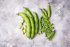 Fresh green peas and beans on light background. Top view Stock Images