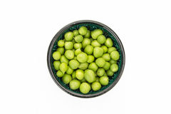 Fresh green peas in bowl Stock Images