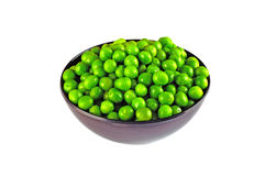 Fresh green peas in a bowl, isolated on white background. Fresh green peas in a black bowl, isolated on white background Royalty Free Stock Images