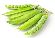 Fresh green peas with drops. On white bsckground Stock Image