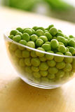 Fresh green peas in glass bowl Stock Photo