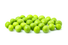 Fresh green peas isolated closeup. Fresh green peas isolated on a white background Stock Photos