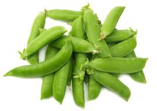 fresh green peas isolated on white background. top view royalty free stock photos