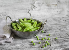 Fresh green peas in a metal bowl Royalty Free Stock Images