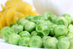 Fresh green peas with other snacks Stock Photos
