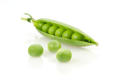 Fresh Green Peas. Pea Pod with Peas  on White Background Stock Photos