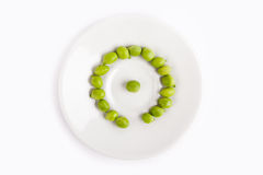 Fresh green peas on plate Stock Photo