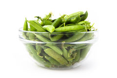 Fresh green peas in a plate Royalty Free Stock Photos