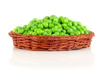 Fresh green peas in the pod isolated on white background.  Royalty Free Stock Images