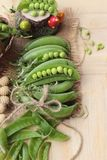 Fresh green peas pod on wood background. Stock Photo