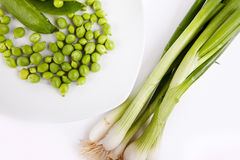 Fresh green peas and spring onion Stock Photo