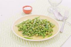 Fresh green peas stews seasoned with mint Stock Photos