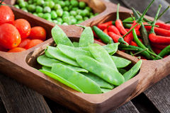 Fresh green peas, tomato and chili Stock Images