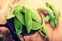 Fresh green peas on vintage scales Stock Image