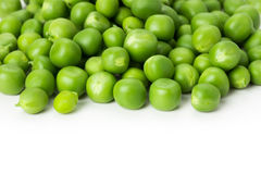 Fresh green peas on the white background Stock Images