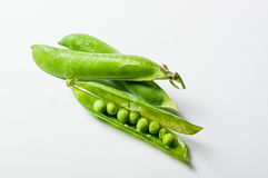 Fresh green peas on white background Stock Images