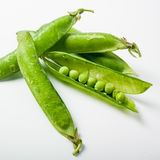 Fresh green peas on white background Stock Photos