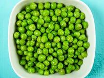 Fresh Green Peas In White Bowl Stock Photo