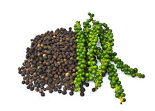 Fresh green peper on heap of Black Pepper Royalty Free Stock Photo